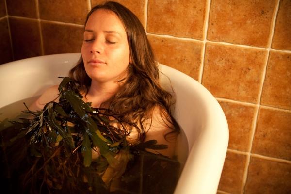 girl in seaweed bath