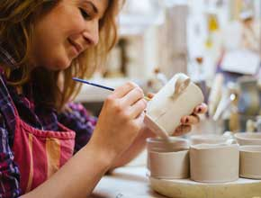 Lady painting pottery, hen party idea