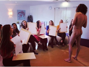 women painting a nude man, great hen party idea