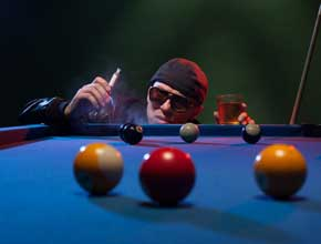 guy playing game of pool stag party idea