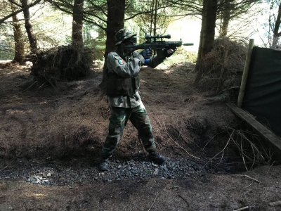 Guy playing airsoft