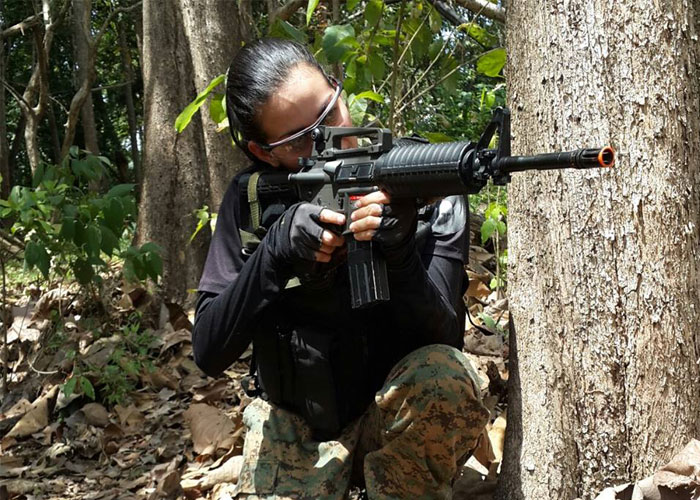 Women playing airsoft