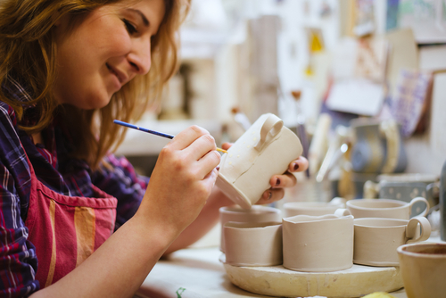 Lady painting pottery